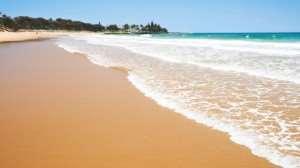 Lapping Waves on a Beach in Australia | Tours of Australia
