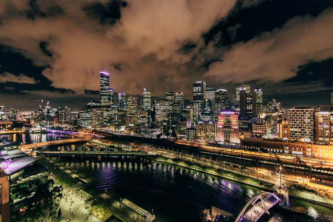 Melbourne skyline at night with clouds