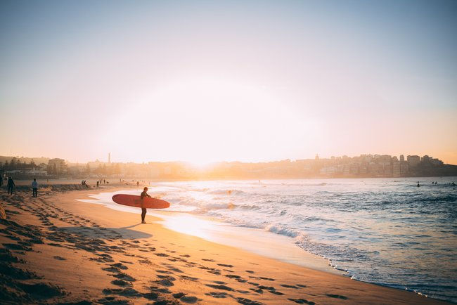 surfer at sun set Bondi Beach Australia