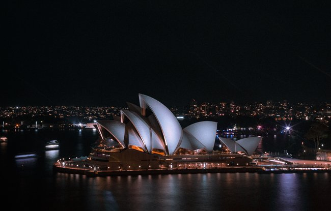 Sydney opera house lit up at night
