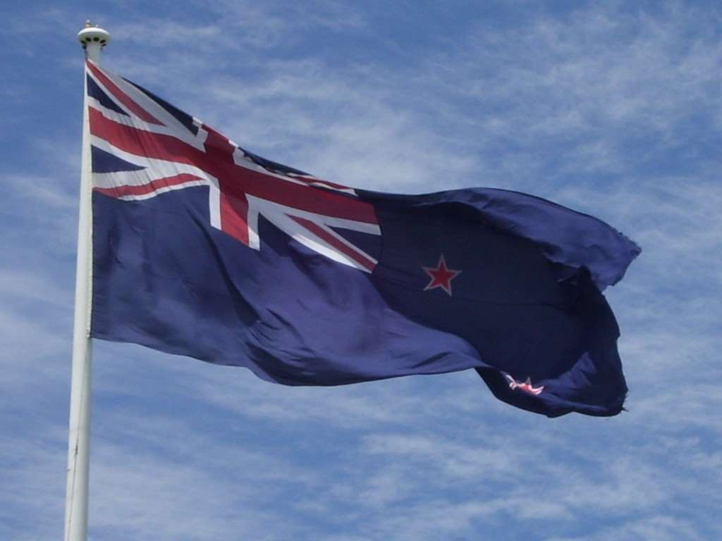 Current New Zealand flag flying in the wind
