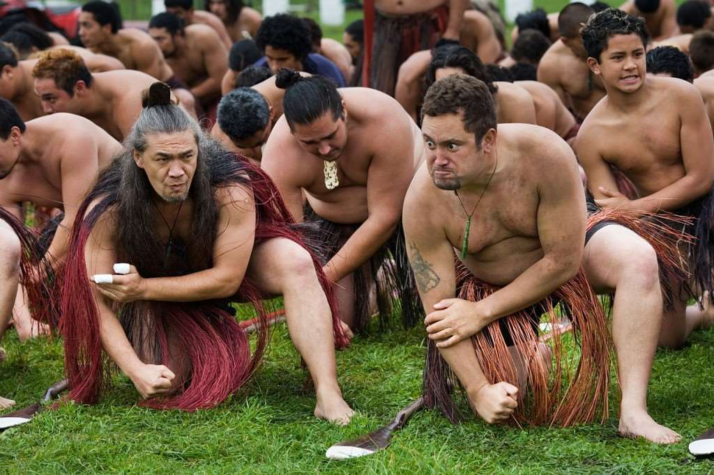 Maori men performing traditional ceremony, as seen on our holidays in New Zealand – Distant Journeys