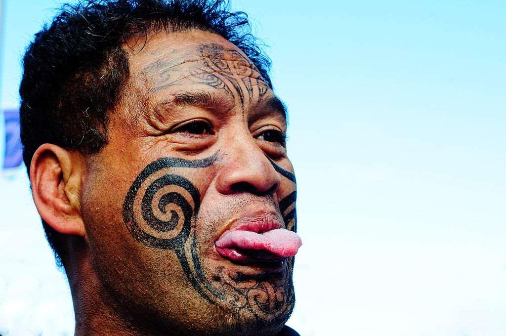 A colour picture of a tattooed Maori man