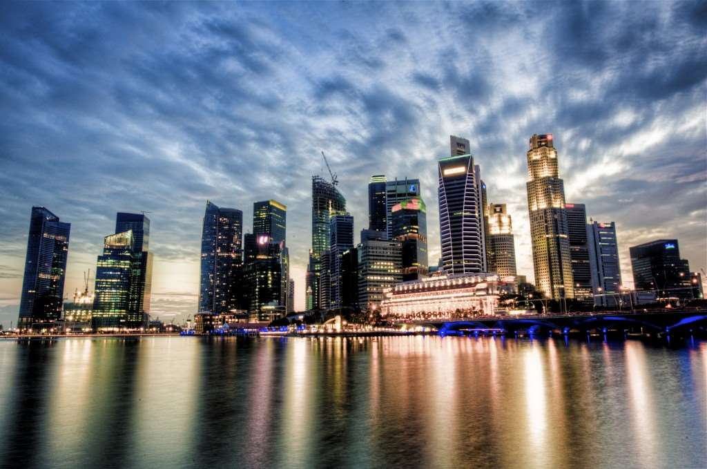 A colour picture of a Singapore business district at dusk.