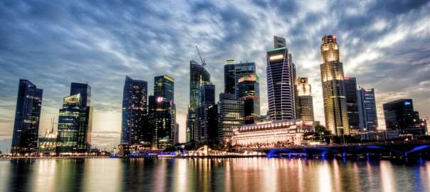 A colour picture of a Singapore business district at dusk.