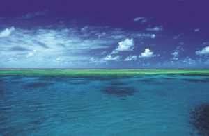 Great Barrier Reef near Cairns, Australia; cloudy sky,
