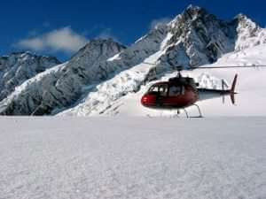 Helicopter flight on snowy mountain