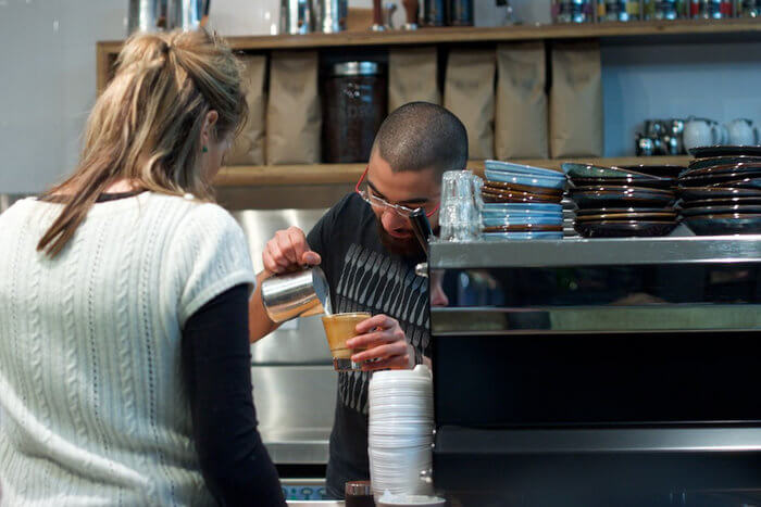 barista serving coffee melbourne australia