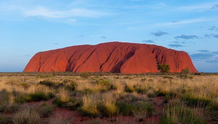 Uluru ayers rock grass and blue skies