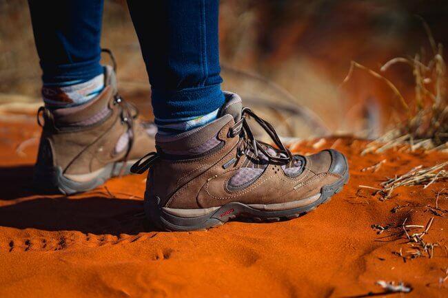 walking boots on red sand uluru