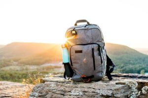 backpack on mountain with shinning sun
