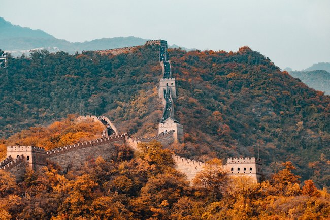 great wall of china with autumnal trees