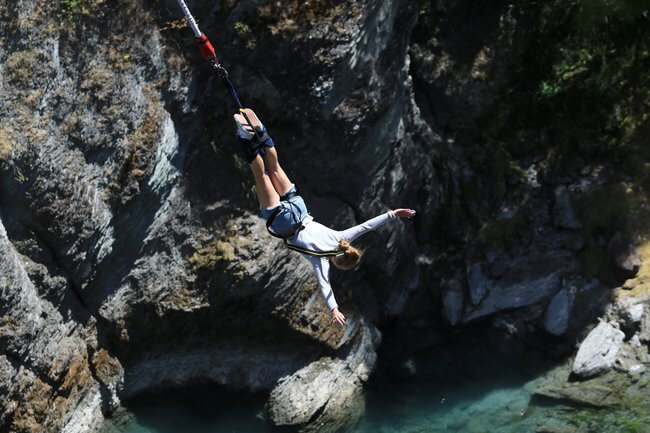 girl bungee jumping kawarau bridge New Zealand