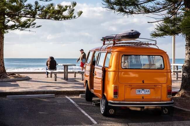 orange campervan overlooking Manly beach Australia