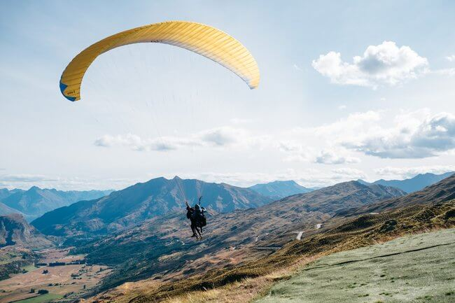 paragliding flight mountains Queenstown New Zealand