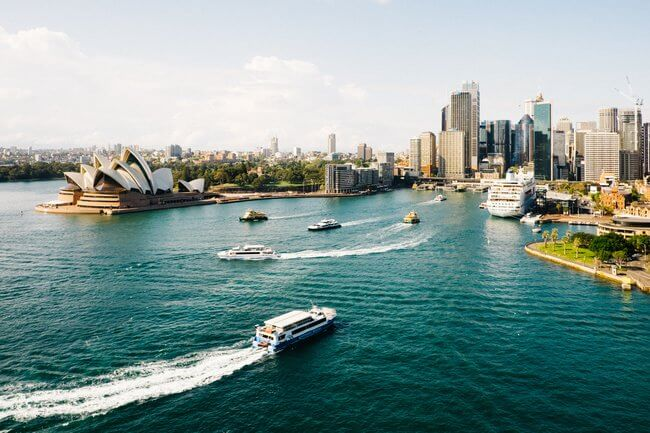 sydney harbour with opera house and boats daytime
