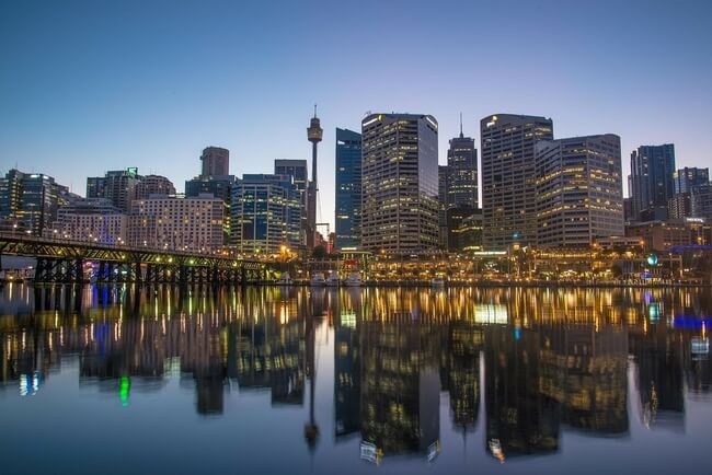Sydney night skyline from harbour with Sydney tower eye