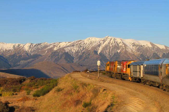 Tranz alpine train with snow capped mountains