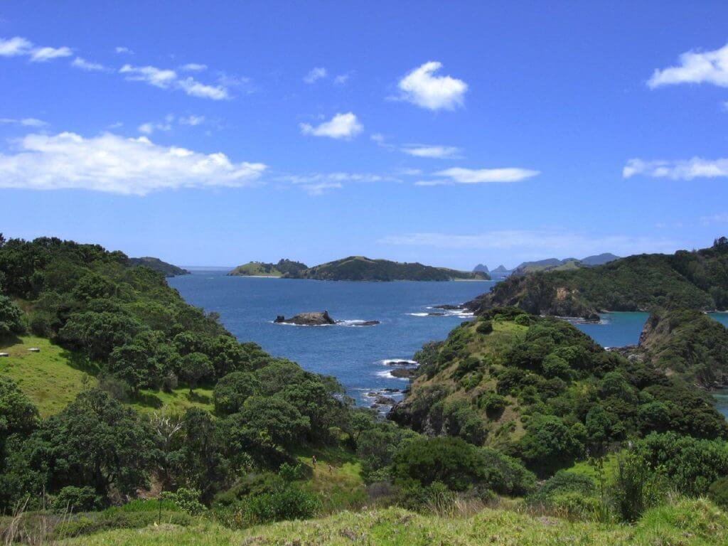 Valley of an island in the Bay of Islands overlooking the deep blue water