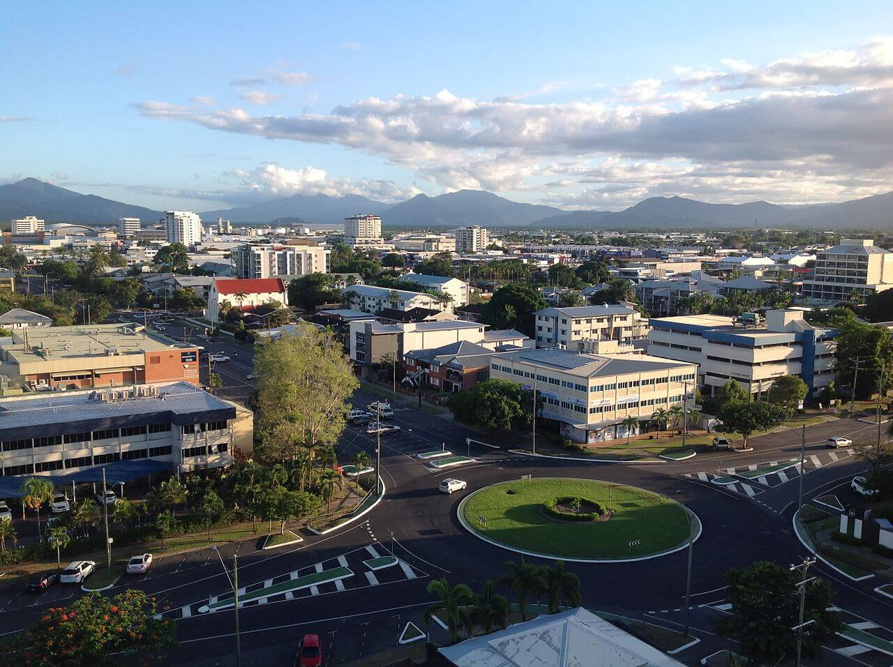 CBD of Cairns in Australia, showing silhouettes of hills in background