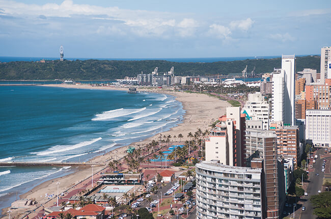 Aerial view of Durban coast, with large buildings neighbouring the golden coast