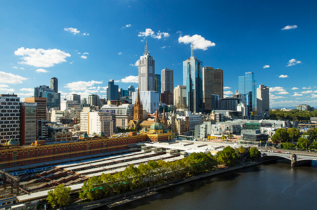 Dense Melbourne CBD with the national train station and modern Federation Square in the foreground
