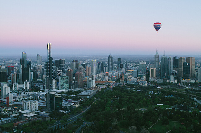 Melbourne Australia skyline at dawn with hot air balloon floating above