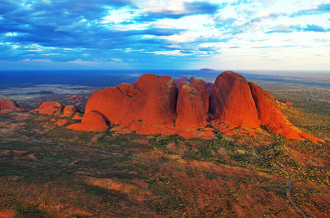Kata Tjuta from the side, showing the eroded rocks and vibrant oranges of this structure
