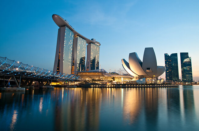 Aerial view of Marina Bay, Singapore at dawn, with the famous Art Science museum in foreground