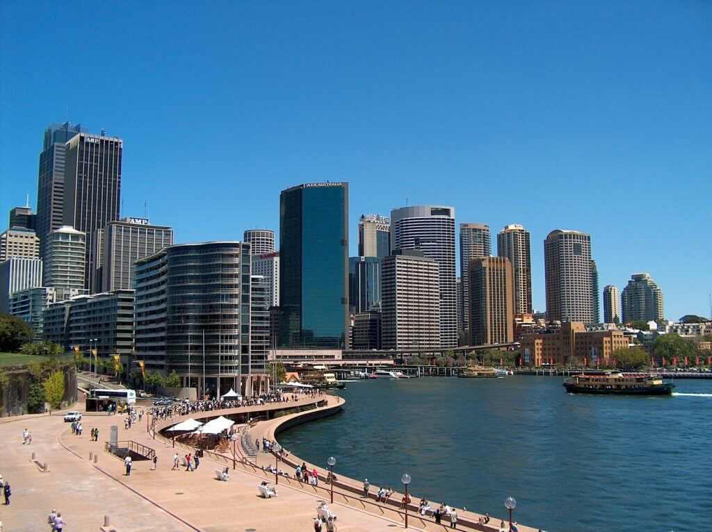 Sydney skyline in the daytime, taken from the edge of the harbour.