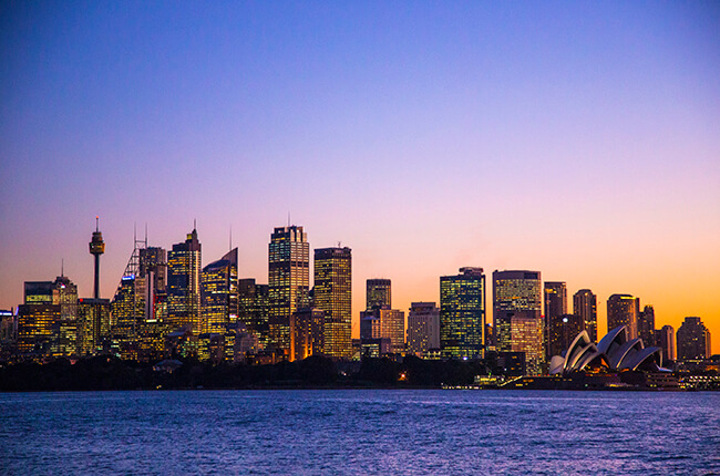 Sydney skyline at sunset, taken from water - Sydney Opera House in foreground