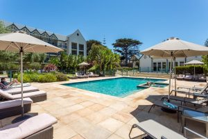 Relaxing by the pool at Portsea Village Resort