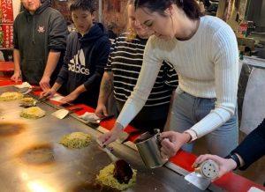 Okonomiyaki making on hot plate in Hiroshima