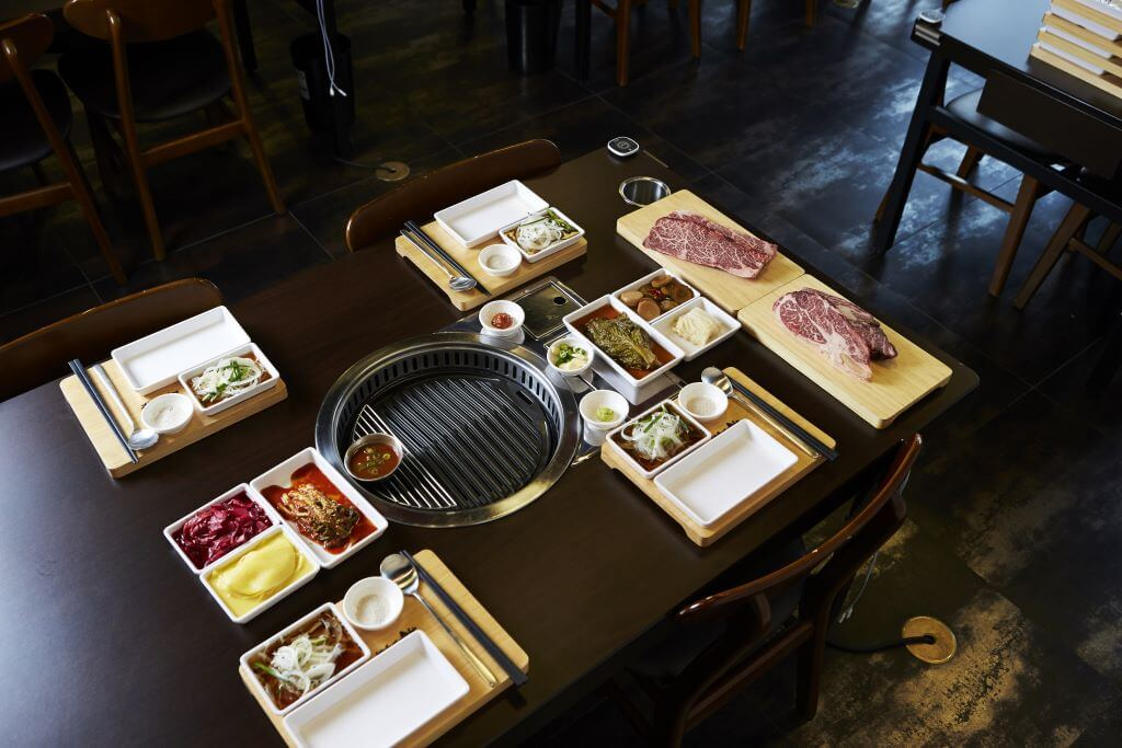 Japanese BBQ with plates set out and beef ready to cook