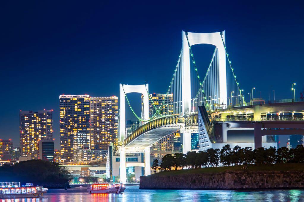 Rainbow bridge over Tokyo River at night