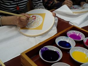craft class making floral design on napkin
