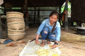 local lady weaving bamboo