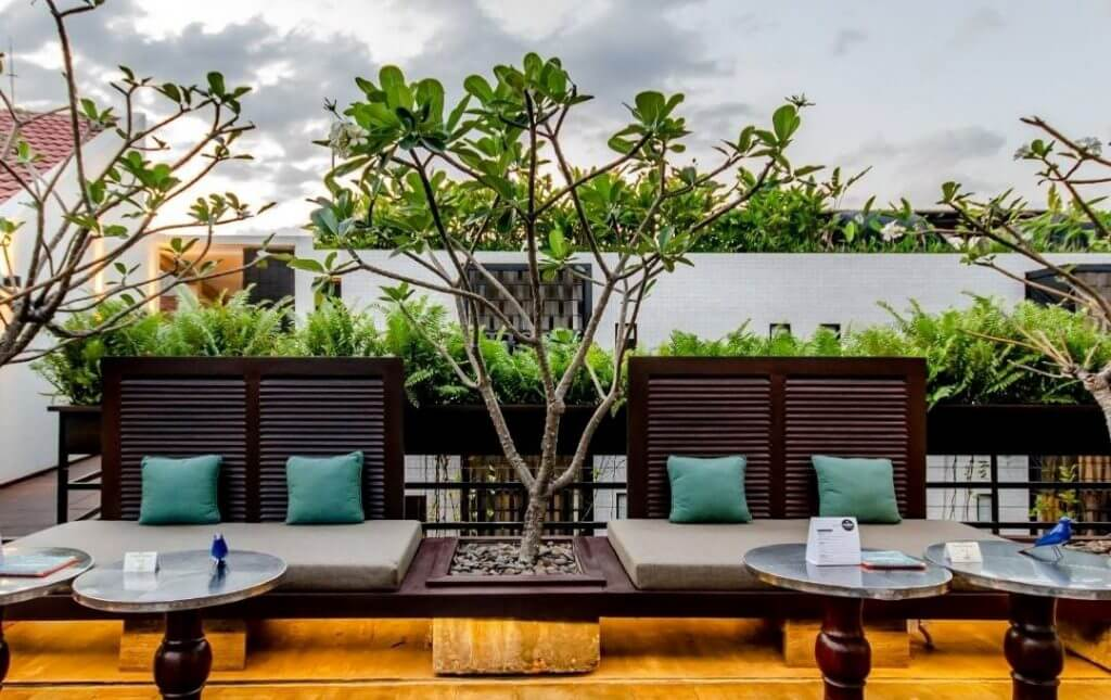 roof terrace with tables and lounge chairs
