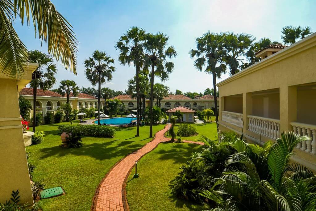 Goa Zuri White Sands exterior gardens and pool