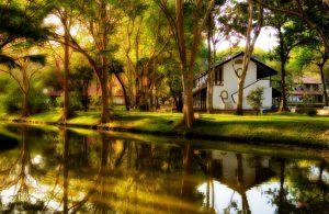 Habarana Cinnamon lodge exterior with lake