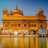 Golden Temple of Amritsar in day with reflection on water