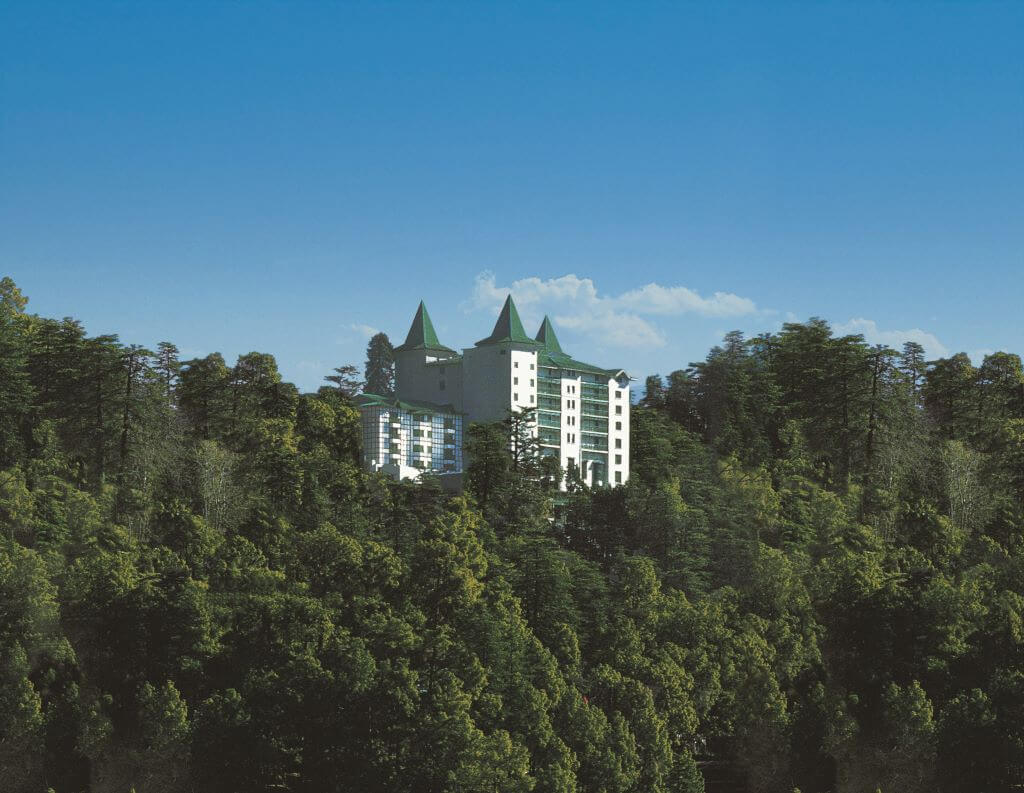 exterior landscape view Oberoi Cecil Hotel in forest in Shimla India
