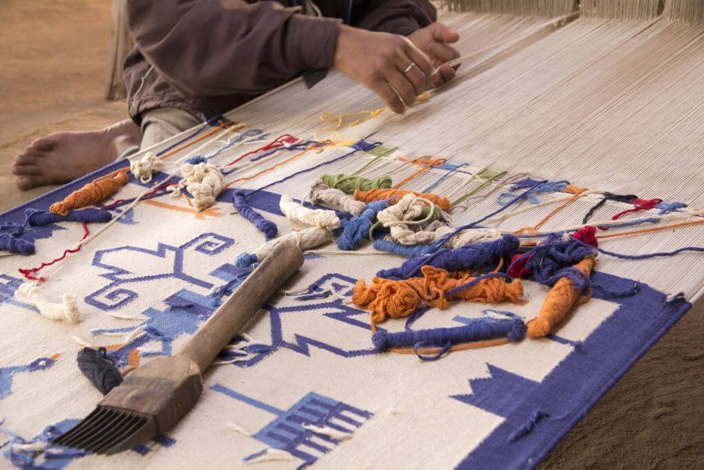 textile artist weaving cotton and embroidery in Udaipur India