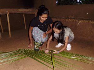 Hiriwaduna locals weaving leaves in Habarana Sri Lanka