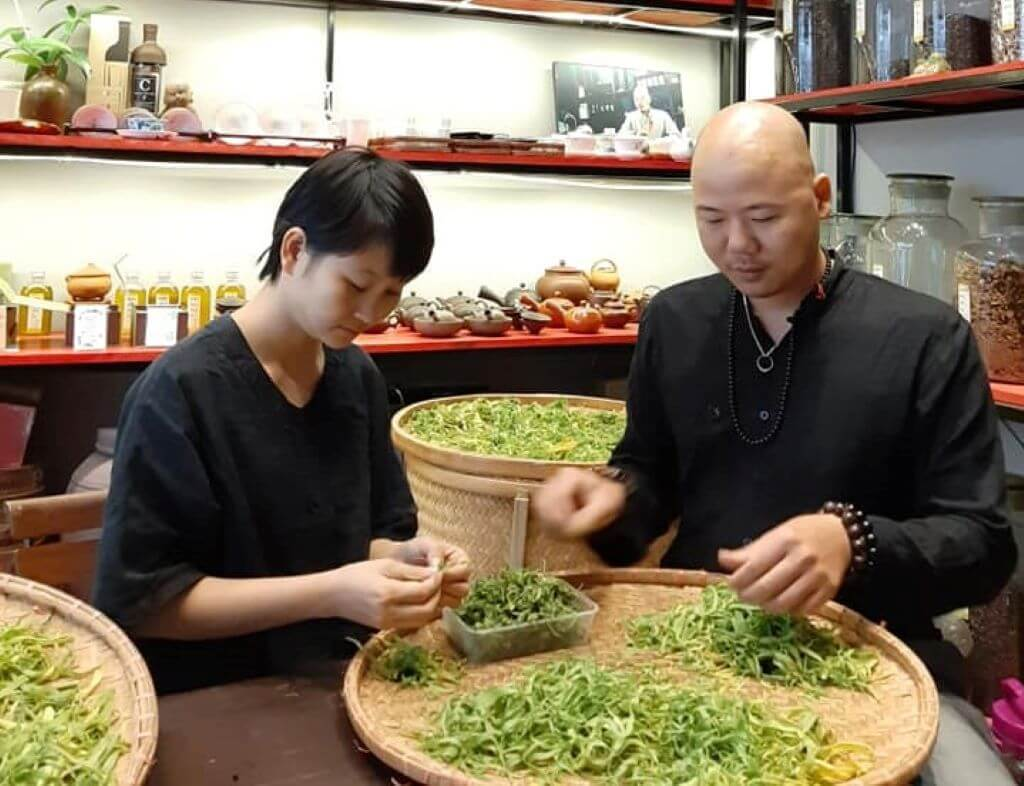 Tea master making tea from leaves in Hanoi Vietnam