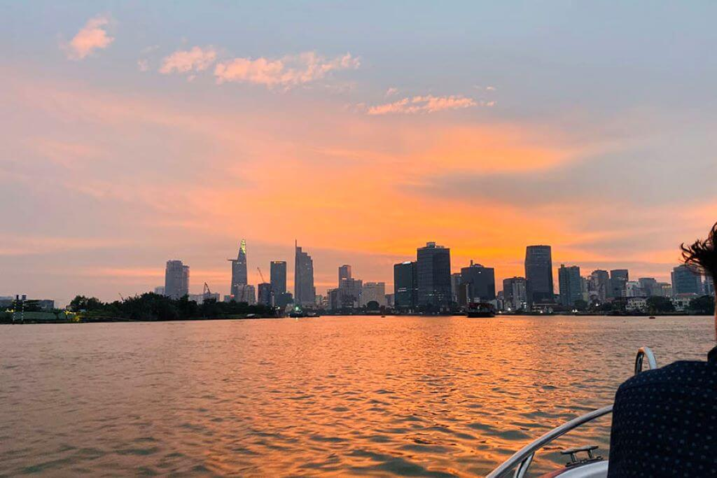 Ho Chi Minh City at sunset taken from boat on the river
