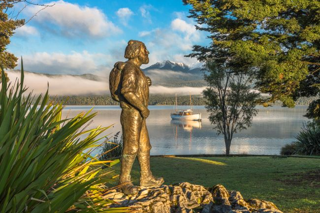 Statue of explorer Quintin Mackinnon by Te Anau lake, New Zealand